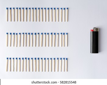 Many matches or matchsticks next to a lighter, showing progress and advancement