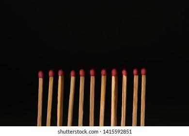 Many matches on black background