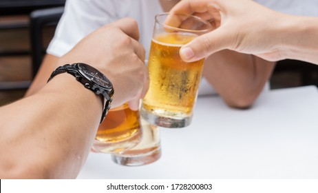 Many men are celebrating with beer during their work holidays.