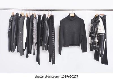 Many Men's black different clothing , set of on the racks