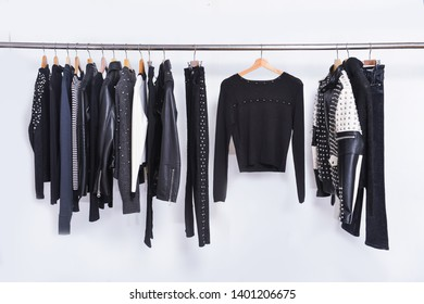 Many Men's black different clothing , set of on the racks