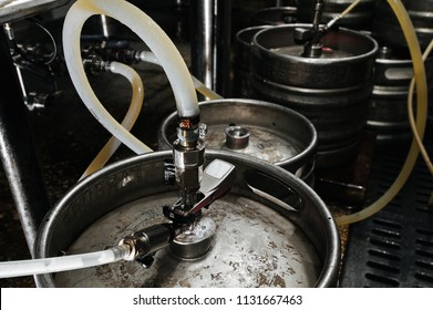 Many metal kegs of beer in beer plant. Bottling beer. Kegs upon kegs at a brewery