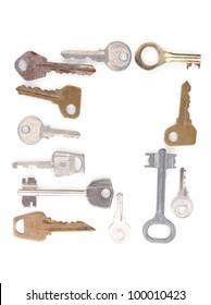 Many metal keys isolated on white