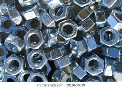 Many metal nuts. Abstract industry background. Natural photo.