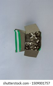 many metal thumb tack on white background in box