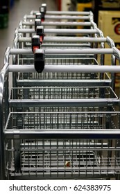 many metallic shopping carts in a row