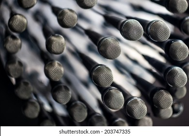 many microphones hanging from the ceiling