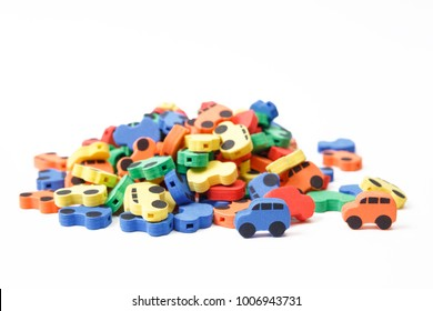 Many multi-colored cars on a white background, isolated. Car dump. Car recycling.