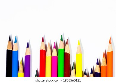 Many multicolored pencils arranged in a graph isolated on white background with copy space, Business and finance background concept