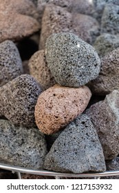 Many multicolored porous pumice stones in view