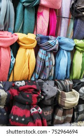 many multi-colored scarves in the store