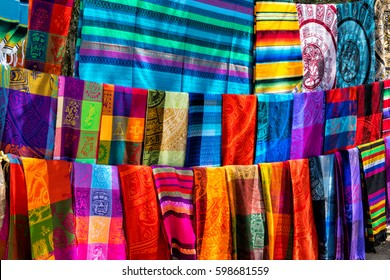 Many multicolored textiles being representative for the latin america culture and sold as souvenirs at chichen itza, yucatan mexico.