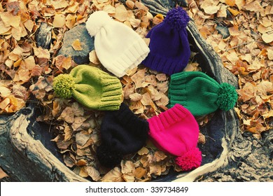 Many multicolored woolen knit hats