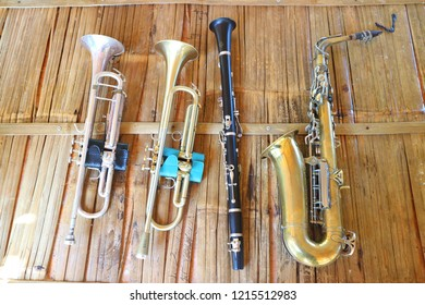 Many musical instruments put on a wooden background.
