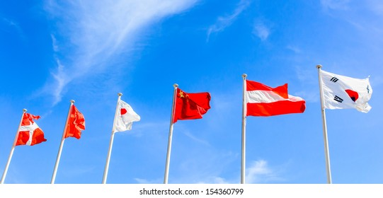 many national of flag pole on blue sky backgrounds