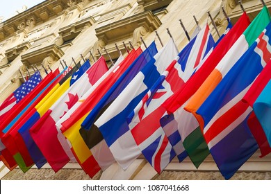 many national flags of different states hang on historical building in Hofburg, Wien. Worldwide, internationa Flags at the HQ of OSCE in Vienna, Austria.