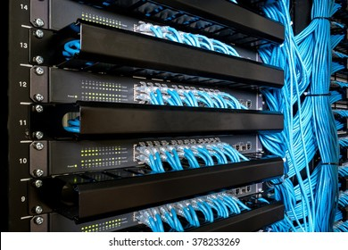 Many network switch hubs and ethernet cable in rack cabinet. Network connection technology and has a status LED to show working status