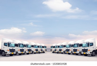 Many of new trucks are parking as fleet as in transport service with blue copy top space sky.
