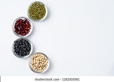 Many nuts and sesame seeds on white background.