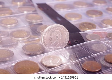 Many obsolete historical coins in the numismatics album