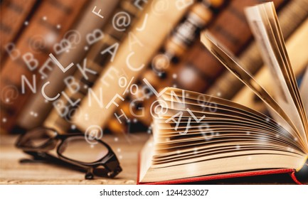 Many old books on wooden background. The source of information. Knowledge is power
