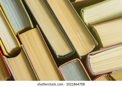 Many old books, top view, like background. The concept of education. A stack of colorful books in a library or a room