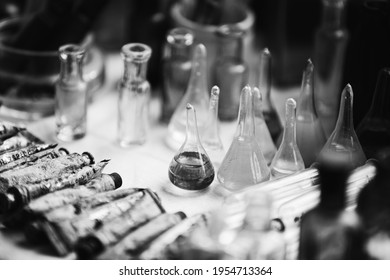 Many Old Deutsch Vintage Medical Glass Capacity. Detail Of Retro Chemical Pharmaceutical Science Researches. Small Bottles Different Sizes From Times Of World War II. WW2 WWII. Black And White.
