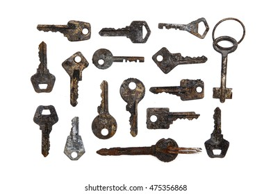 Many old keys on white background
