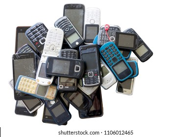 Many old mobile phones are technologically outdated, Unwanted mobile phone On white background.