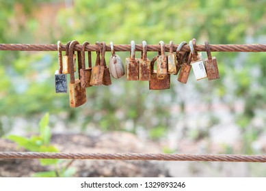 many old rust key lock with rust iron fence.