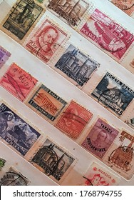 many old stamps on a philately catalog page 02.Jul.2020 in Sovata city - Romania