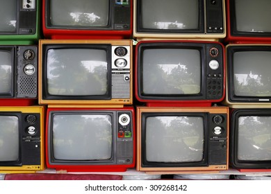 Many old televisions bundled together