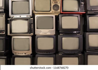 Many old TV wall piled together, pattern, retro television filter style