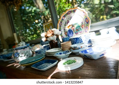 many old vintage thai ceramic table ware on table