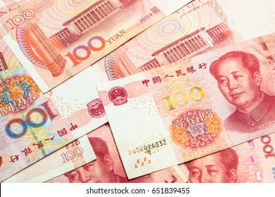 Many of one hundred Chinese yuan banknotes, Chinese currency as background.