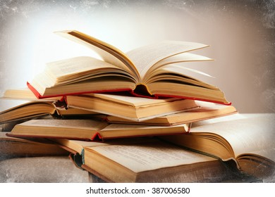 Many open books on light background