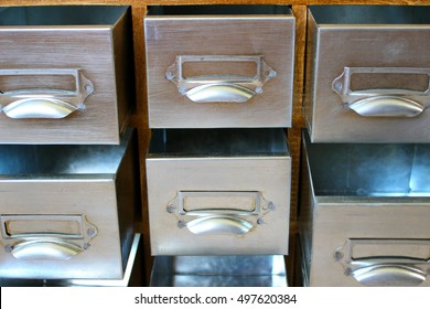 Many open empty metal drawers.