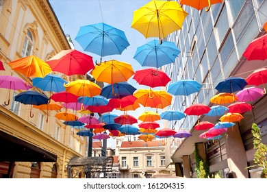 Many open in the sky umbrellas  give a guarantee that the rain will not spoil the day, Belgrade, Serbia.