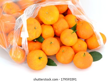 Many oranges packed in plastic bags, placed on a white background.