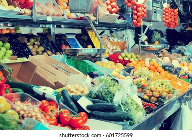 Many organic produce at market counter