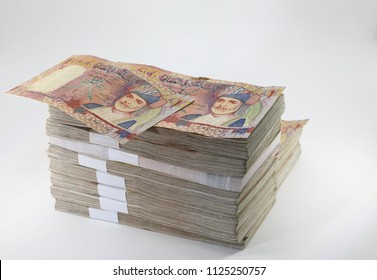 Many packs of Oman Baisa bills, stacks of banknotes, pile of cash, paper money. The concept of financial success, Investment and wealth. isolate on white background.