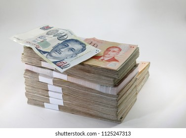 Many packs of Singapore Dollar bills, stacks of banknotes, pile of cash, paper money. The concept of financial success, Investment and wealth. isolate on white background.