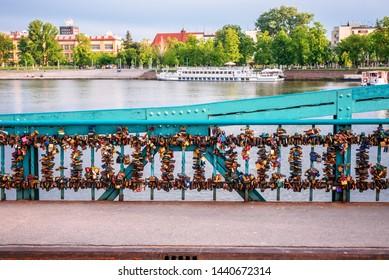 many padlocks on the love bridge in Wroclaw