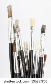 many paint brushes, new and used