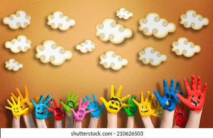 many painted children hands with smileys