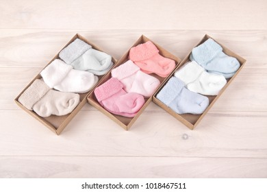 Many pairs of child's striped socks, for backgrounds or textures.