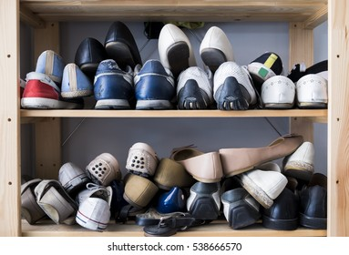 Many pairs of shoes on a shelves