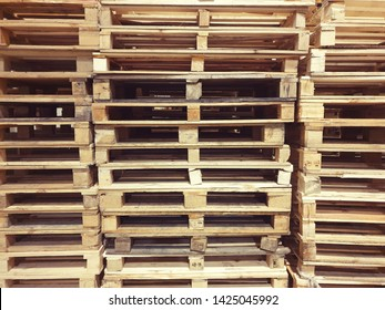 Many pallets stacked in stock, warehouse pallets, blue wooden pallets