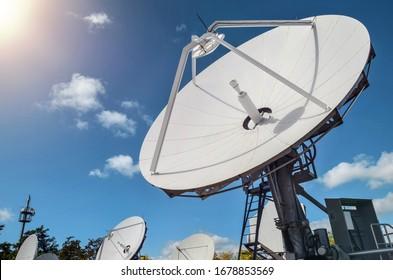 Many parabolic antennas against blue sky