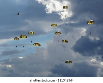 Many paratroopers dropped on the battlefield in Europe. Dramatic scenery.